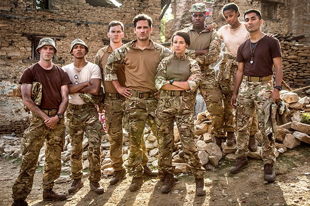 Simon (third from left) pictured with the cast from Our Girl.